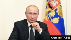 Russian President Vladimir Putin takes part in a video conference call with officials and public representatives of the region of Daghestan on May 18.