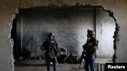 Дар инҷо дар шаҳри Мосул ҷангҷӯён замоне бомб месохтанд.