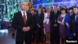 "Russian President Vladimir Putin makes his annual New Year address to the nation in the far eastern city of Khabarovsk on December 31, where he vowed to ""fiercely and consistently continue the fight against terrorists."""