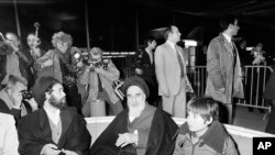 FRANCE -- file -- Ayatollah Ruhollah Khomeini talks briefly with reporters at Roissy-Charles de Gaulle Airport, Jan. 31, 1979,