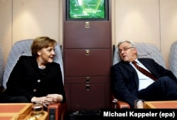 Chancellor Merkel and Foreign Minister Frank-Walter Steinmeier on board a government plane in 2006.