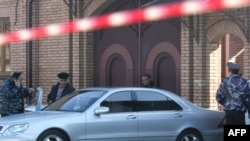 Forensics experts examine the crime scene and car of Vladikavkaz Mayor Vitaly Karayev
