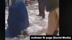 A screen grab from an amateur video of a mob beating an Afghan woman in Takhar Province because she allegedly had an extramarital affair. The woman survived the incident.