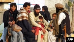 Internally displaced Pakistani civilians, fleeing from military operations against Taliban militants in North Waziristan, arrive in Bannu, a town on the edge of the largely lawless tribal area, on January 21.