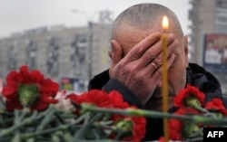 A man reacts at the monument commemorating the Soviet victims of the war in Afghanistan, in St. Petersburg in 2016.
