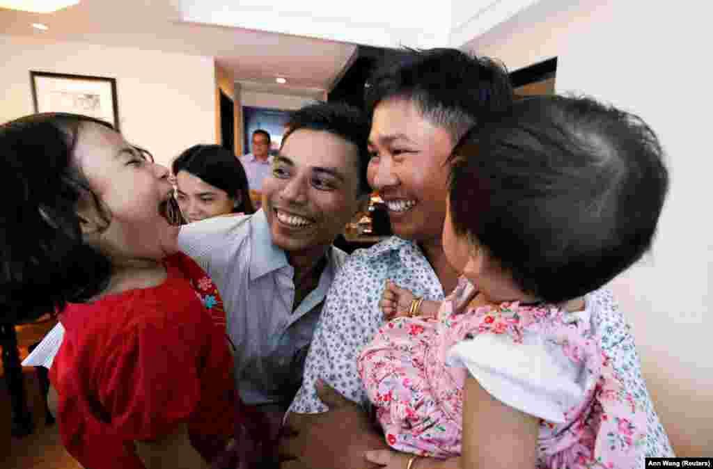 Reuters reporters Wa Lone and Kyaw Soe Oo celebrate with their children after being freed from prison, after receiving a presidential pardon in Yangon, Burma. The two spent more than 500 days behind bars on convictions for breaking the colonial-era Official Secrets Act. (Reuters/Ann Wang)
