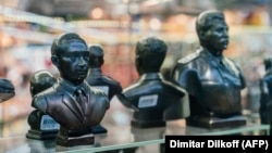 Busts of Russian President Vladimir Putin (left) and Soviet dictator Josef Stalin are seen among other items at a gift shop in Moscow on March 11.