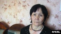 Гүлсім Өтегенова, тіл-құлағы кеміс баланың анасы. Қандыағаш, 27 желтоқсан 2009 жыл.