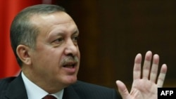 Turkey -- Prime Minister Recep Tayyip Erdogan addresses members of parliament from his ruling AK Party in Ankara, 19Apr2010