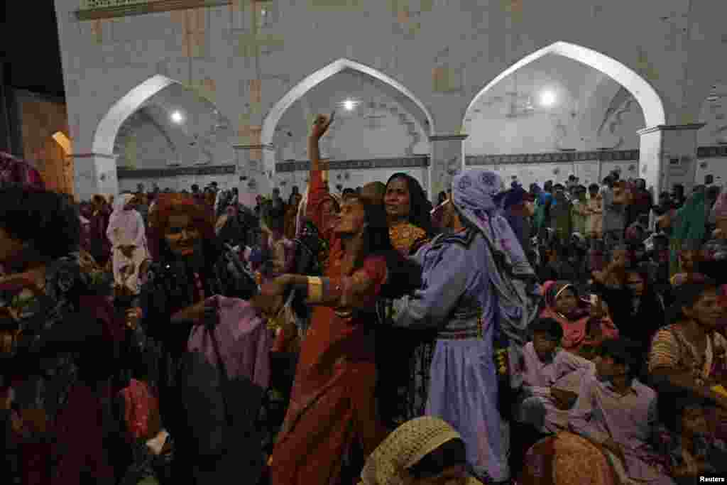A woman devotee dances in a trance inside the shrine in 2013. Lal Shahbaz Qalandar, the Sufi saint interred here, is revered by both Sufi Muslims and Hindus.