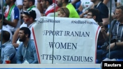 Fans hold a banner supporting Iranian women at a World Cup match in St. Petersburg on June 15.