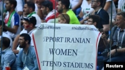 General view of a banner displayed by fans referring to the ban for Iranian women during the World Cup in Russia. June 15, 2018
