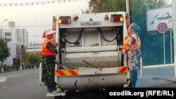 Uzbekistan - Uzbek women working with collecting garbage car, undated
