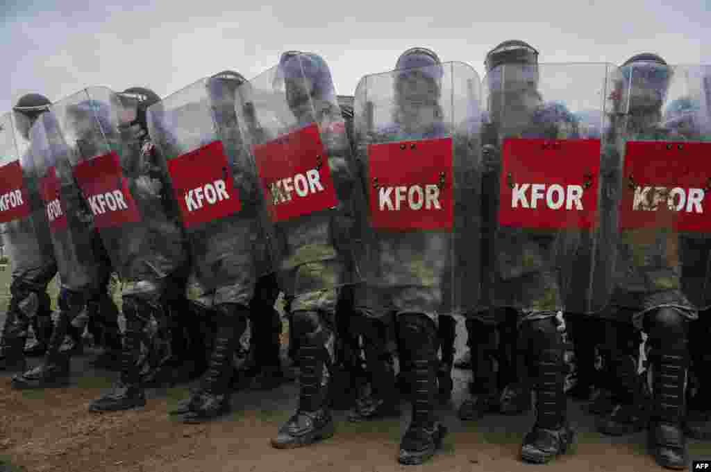 Turkish soldiers serving in the NATO-led Kosovo peacekeeping force, KFOR, hold a line with shields during a crowd-and-riot-control exercise near the town of Ferizaj. (AFP/Armend Nimani)