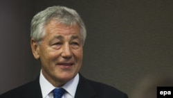 Chuck Hagel has promised to resign from any organization that poses a conflict of interest.