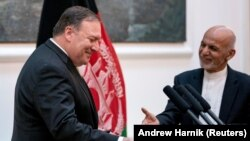 FILE: Afghan President Ashraf Ghani and Secretary of State Mike Pompeo shake hands following a news conference at the Presidential Palace in Kabul, July 2018.