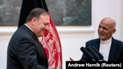Afghan President Ashraf Ghani and Secretary of State Mike Pompeo shake hands following a news conference at the Presidential Palace in Kabul, Afghanistan July 9, 2018