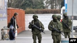 "Ukraine -- Unidentified armed men patrol outside of Simferopol airport on February 28, 2014. Ukraine accused today Russia of staging an ""armed invasion"" of Crimea and appealed to the West to guarantee its territorial integrity after pro-Moscow gunmen took"