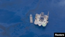An aerial view of the area where BP's Deepwater Horizon drilling rig exploded last month and sank in the Gulf of Mexico