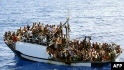 World -- photo released by French authorities of fishing boat carrying around 300 illegal migrants in Mediterranean Sea before 24sep2008