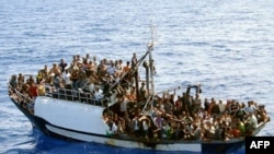 A photo released by French authorities of a fishing boat carrying around 300 illegal migrants in the Mediterranean Sea before being intercepted in September 2008.