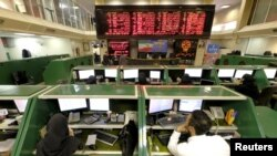 Stock-market employees work at Tehran's Stock Exchange on January 17.