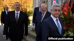Switzerland - Presidents Serzh Sarkisian (R) of Armenia and Ilham Aliyev of Azerbaijan begin negotiations in Geneva, 16Oct2017.