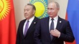 Russian President Vladimir Putin (right) could be looking for inspiration in the way his old Kazakh counterpart, Nursultan Nazarbaev, has stepped down but is still keeping his irons in the fire.