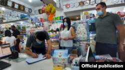 Armenia -- Officials from Armenia's Health and Labor Inspectorate inspect a supermarket in Yerevan to verify its compliance with coroanvirus safety rules, July 22, 2020.