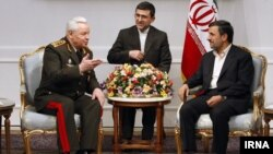 Azerbaijan Defense Minister General Safar Abiyev (left) appears with Iranian President Mahmud Ahmadinejad (right) in Tehran on March 13.