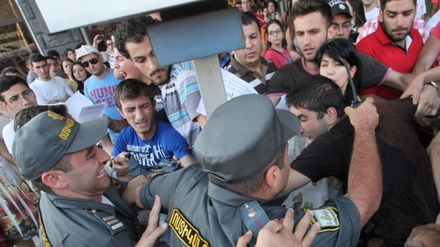Armenia - Riot police confront youth activists protesting against higher bus fares in Yerevan, 22Jul2013.
