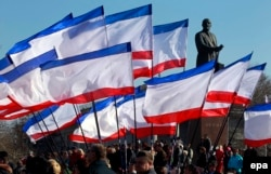 Pro-Russian demonstrators rally in Crimean capital, Simferopol, in February last year.