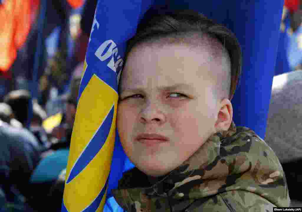 A young ultra-right activist holds a flag as he attends a rally in central Kyiv. (AP/Efrem Lukatsky)