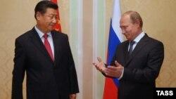 Голова КНР Сі Цзіньпін та президент Росії Володимир Путін, Душанбе, 11 вересня 2014 року