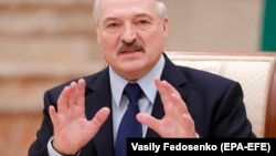 Belarusian President Alyaksandr Lukashenka reacts during a meeting with the media in Minsk on December 14.