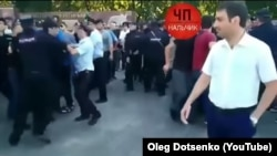 A screen-grab from a YouTube video posted on an account under the name of Oleg Dotsenko apparently showing scenes from a demonstration in Nalchik, the capital of Kabardino-Balkaria, during which Kabardians demanded that authorities open a probe into what they contend was a brutal crackdown targeting them.