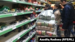When news of the Central Bank's decision reached the streets, people across Azerbaijan rushed to shops to scoop up whatever they could before prices adjusted to the new reality.