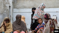 FILE: Mothers whose children were sexually abused by a gang gather at a house in the village of Hussain Khanwala in Kasur district of the eastern province of Punjab.
