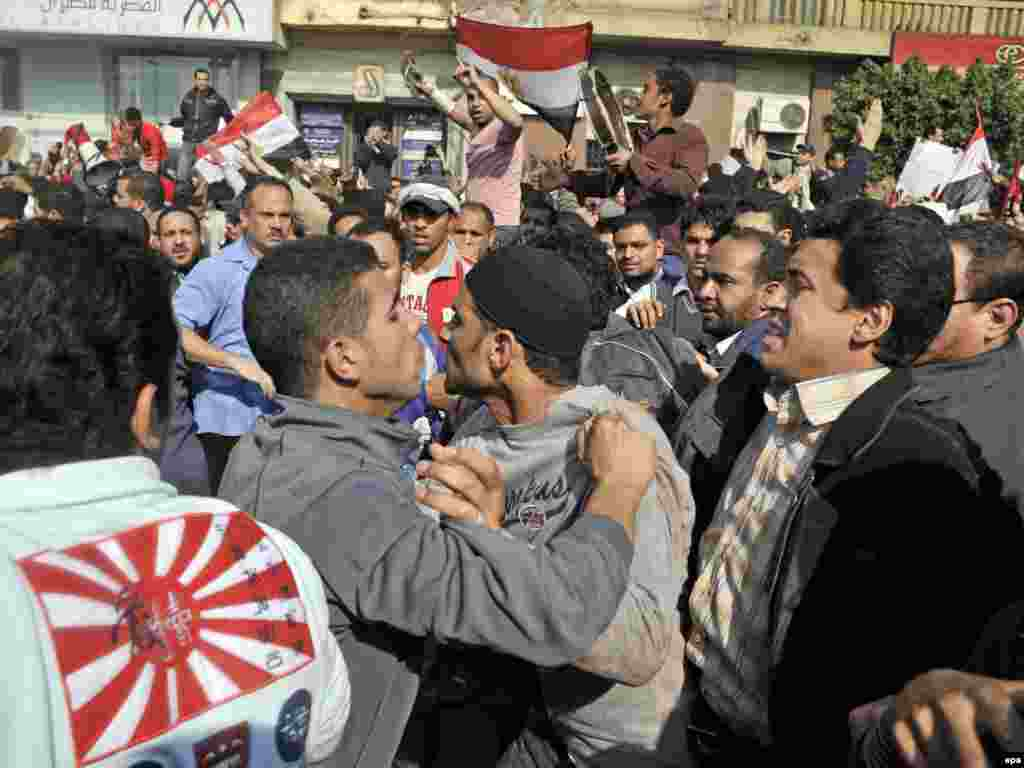 Pro- and anti-Mubarak demonstrators face off in Cairo's Tahrir Square, minutes before clashes started.