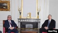 Армениянын президенти Серж Саргсян менен Азербайжандын президенти Илхам Алиев. Швейцария, 19-декабрь,