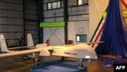 "The Iranian-made missile-equipped ""Fotros"" drone is unveiled during a ceremony in Tehran on November 18."