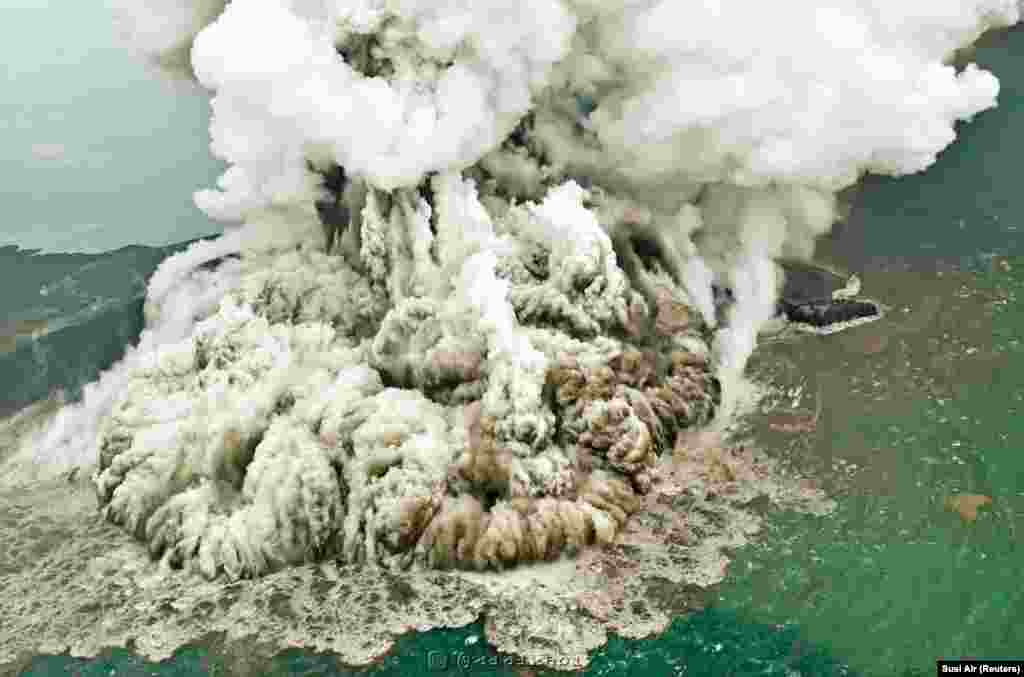 A plume of ash rises as the Anak Krakatau volcano erupts in Indonesia, causing a deadly tsunami that killed hundreds. (Reuters/Susi Air)