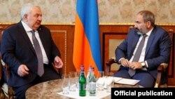 Armenia -- Armenian Prime Minister Nikol Pashinian (R) meets CSTO chief Yuri Khachaturov, Yerevan, 17May2018