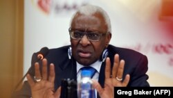 International Association of Athletics Federations President Lamine Diack gestures during a press conference in Beijing in August 2015.