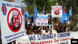"""Demonstrators in Hyderabad, Pakistan on May 19 hold banners and shout sloagans against the """"Everybody Draw Muhammad Day"""" Facebook event."""