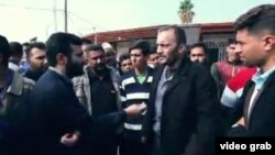 A resident of Taleghani neighborhood in Mahshahr city rejects the formal narration of government on the crackdown of protests in November 2019. FILE PHOTO