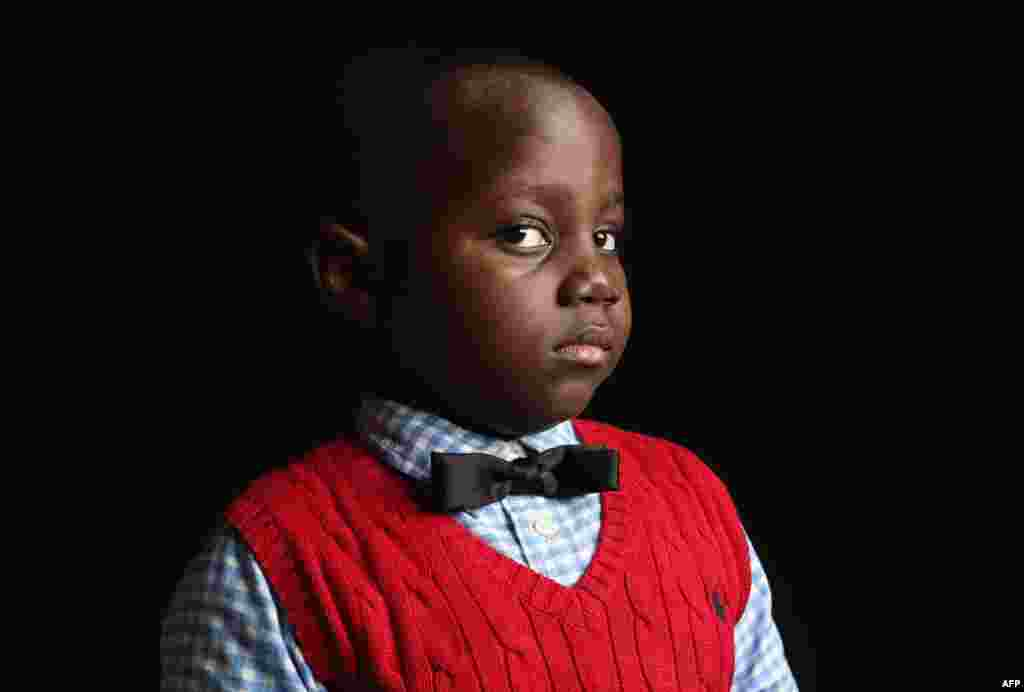 Ifeozuwa Oyaniyi, 5, was born in Nigeria. His father, Oluwaseyi Oyaniyi, is a housing inspector, and their family lives in the Bronx, New York City.