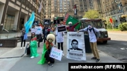Turkmen opposition activists abroad, such as these demonstrating in New York, face pressure and threats to relatives back home.