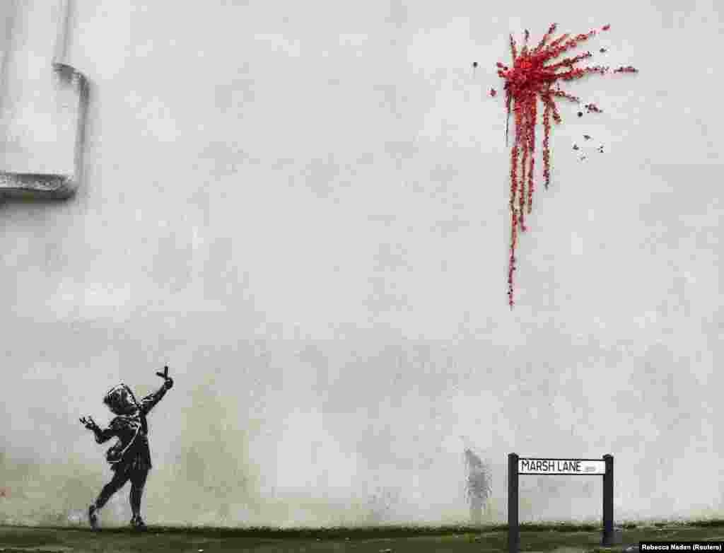 A suspected new mural by the artist Banksy appeared in Marsh Lane in Bristol, United Kingdom on February 13. (Reuters/Rebecca Naden)