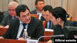 Shamil Atakhanov (left, in file photo) previously headed the Kyrgyz National Security Committee.